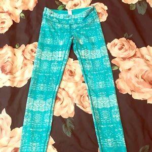 Girl Ivivva turquoise full length legging.